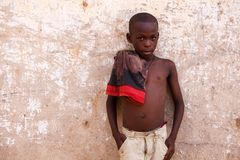 ACCRA, GHANA � MARCH 18: Unidentified young african boy pose wi stock photo