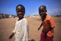 ACCRA, GHANA � MARCH 18: Unidentified african boys greeting to t Royalty Free Stock Images