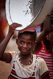 ACCRA, GHANA � MARCH 19: Unidentified young African girl carry t Royalty Free Stock Photo