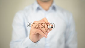 Accredited, man writing on transparent screen. High quality Royalty Free Stock Photo