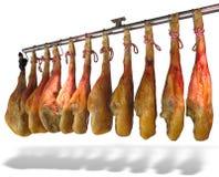 Accrocher espagnol de jamon de jambon d'isolement sur le blanc Photographie stock libre de droits
