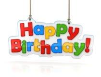 Accrocher multicolore de mot de joyeux anniversaire, d'isolement sur le blanc Image stock