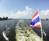Accross the river, thailand flag. River cruise activity in Bangkok, Thailand Royalty Free Stock Photography