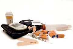 Accuchek and meds. Isolated shot of diabetic monitoring gadgets including medications stock photography