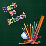 Accueil de nouveau au fond d'école avec l'équipement d'école Photo stock