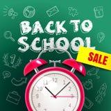 Accueil de nouveau au fond de vente d'école avec le réveil et le blac Photographie stock libre de droits