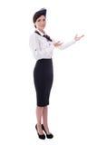 Accueillant le steward (hôtesse de l'air) d'isolement sur le blanc Image libre de droits