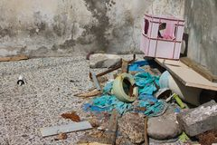Accumulation of garbage near the old house royalty free stock photography