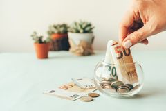 Accumulation of money in a glass jar royalty free stock images