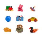 Accumulazione Assorted dei giocattoli isolata su bianco Immagini Stock