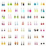 Accumulazione degli anelli di orecchio su priorità bassa bianca Immagini Stock Libere da Diritti