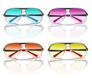 Accumulazione degli occhiali da sole variopinti Fotografie Stock Libere da Diritti