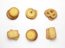 Accumulazione dei biscotti su una priorità bassa bianca Immagine Stock