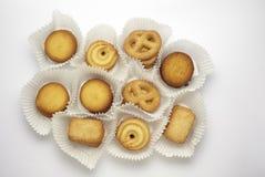 Accumulazione dei biscotti su una priorità bassa bianca Fotografia Stock Libera da Diritti