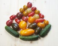 Accumulazione dei cetrioli e dei pomodori Fotografia Stock