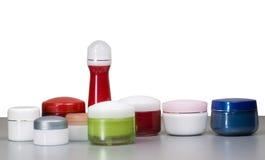 Accumulazione dei contenitori per le attrezzature cosmetiche Fotografia Stock
