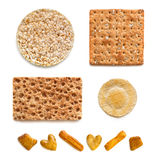 Accumulazione dei cracker sopra bianco Fotografie Stock