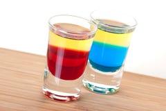 Accumulazione del cocktail del colpo: Tequila rosso e blu Fotografia Stock Libera da Diritti