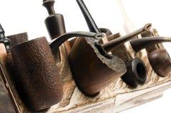 Accumulazione del tubo sulla cremagliera di tubo moderna Fotografie Stock