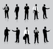 Accumulazione della siluetta dell'uomo d'affari Immagine Stock