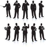 Accumulazione della siluetta dell'uomo d'affari Immagine Stock Libera da Diritti