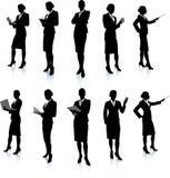Accumulazione della siluetta della donna di affari Fotografie Stock Libere da Diritti