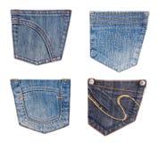 Accumulazione delle caselle dei jeans isolata su bianco Fotografia Stock