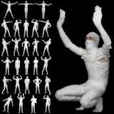 Accumulazione delle mummie bendate isolate sul nero Fotografia Stock