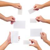 Accumulazione delle schede in bianco in una mano Fotografie Stock Libere da Diritti