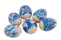 Accumulazione delle uova di Pasqua Su un bianco Immagini Stock Libere da Diritti