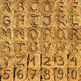 Accumulazione di alfabeto della sabbia Fotografia Stock