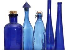 Accumulazione di bottiglie blu dell'annata Fotografia Stock