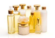 Accumulazione dorata dei prodotti di bellezza Fotografia Stock