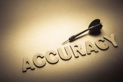 Accuracy and dart. Wood letters of Accuracy word with dart Stock Photography