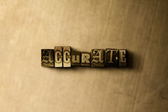 ACCURATE - close-up of grungy vintage typeset word on metal backdrop Royalty Free Stock Image