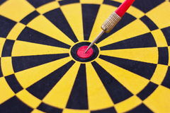 Accurate. Close up image of dartboard and arrow to show concept of accurate in business by image of arrow on the middle of dartboard Stock Image