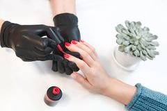 Accurate work of master on manicure in woman`s salon stock photography