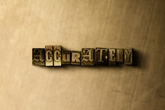 ACCURATELY - close-up of grungy vintage typeset word on metal backdrop Royalty Free Stock Image
