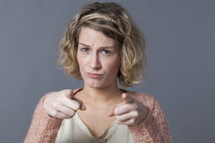 Accusation and worry concept for upset 20s woman Stock Image