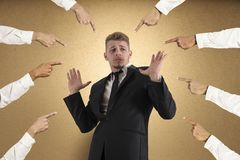 Accused businessman. Concept of accused businessman with fingers pointing Stock Photo