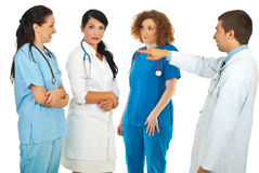Accuser doctor pointing to his team Royalty Free Stock Photography