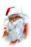 Accusing finger ..naughty or nice?. Santa clause points an accusing finger to check if you have been naughty or nice.  Santa has on a white glove and wire rim Royalty Free Stock Photography