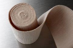 Ace bandage. Close-up shot of unrolled ace bandage shot of stainless medical tray Royalty Free Stock Photos