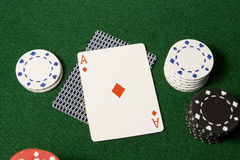 Ace card and gambling chips. A blackjack hand with Ace of diamonds and gambling chips viewed from overhead royalty free stock photos