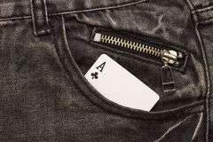 Ace card inside gray jeans pocket with zip lock Royalty Free Stock Photography