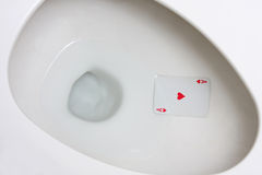 Ace Card in Toilet Hole. Bad luck is unfortunate but sometimes our Ace in the Hole ends up in the toilet stock photo