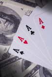 Ace cards on money Royalty Free Stock Image