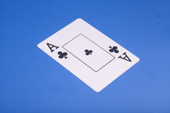 Ace of Clubs. On blue background Royalty Free Stock Photography