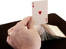 Ace on Deck. Ace sits on raised and fanned card deck, held with one hand as in display of dexterity by magician or gambler Royalty Free Stock Images