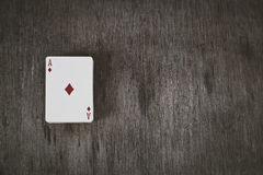 Ace of diamonds. playing cards on a wooden background. Risk and Gambling background, abstract. studio shot. Stock Photography